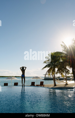 Silhouette of young woman on coast, Providenciales, Turks and Caicos Islands, Caribbean - Stock Photo