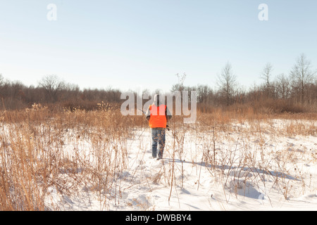 Teenage boy out hunting in Petersburg State Game Area, Michigan, USA - Stock Photo