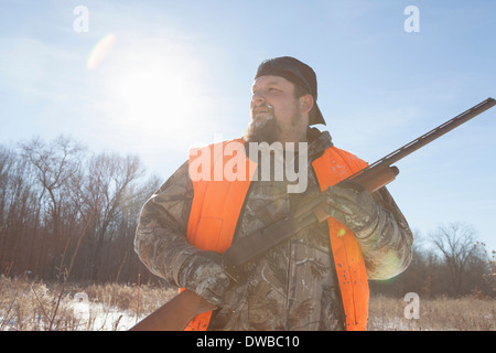 Mid adult man holding shotgun in Petersburg State Game Area, Michigan, USA - Stock Photo