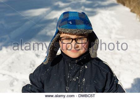 Portrait of boy wearing winter hat, smiling - Stock Photo
