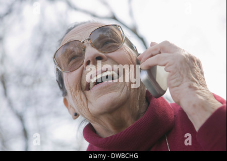 Portrait of senior woman on the phone - Stock Photo