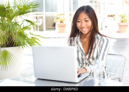 Beautiful asian girl working on her laptop, businesswoman or student - Stock Photo