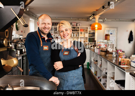 Mature couple in coffee shop kitchen - Stock Photo