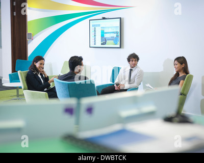 Workers relaxing in modern office - Stock Photo
