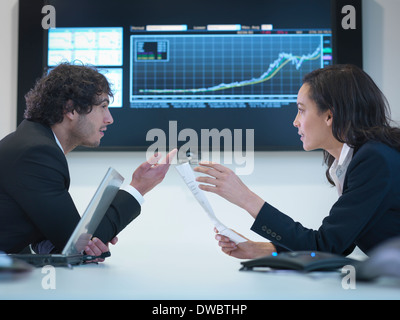 Business colleagues in meeting in front of screen in office - Stock Photo