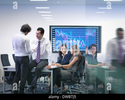 Office colleagues in informal meeting - Stock Photo