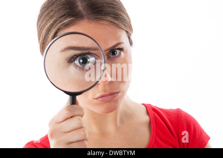 Cute woman looking through a magnifying glass, isolated on white - Stock Photo