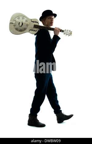 Young man with bowler hat holding guitar on his shoulder - Stock Photo
