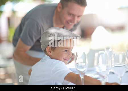 Father and son setting table - Stock Photo