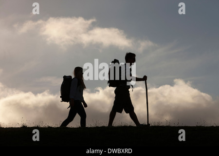 Hikers with backpack and walking stick - Stock Photo