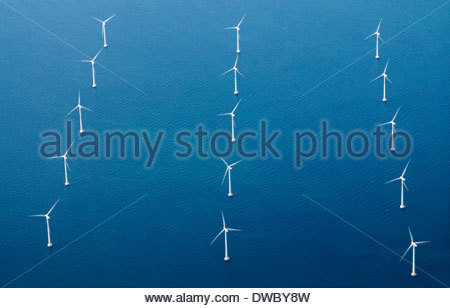 Rows of wind turbines in blue sea - Stock Photo