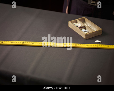 Still life of chalk and ruler in traditional tailors shop - Stock Photo