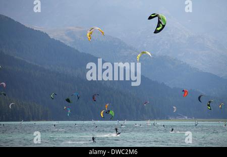 Switzerland, Upper Engadin, Silvaplana, kitesurfers on Lake Silvaplana - Stock Photo