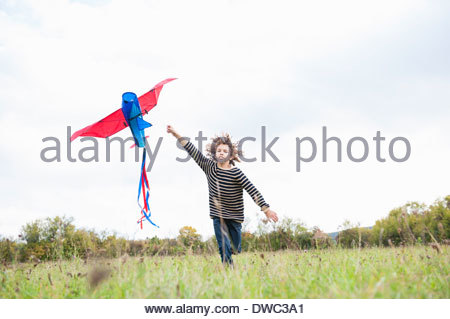 Boy flying kite - Stock Photo