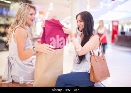 Young woman showing off new shirt - Stock Photo