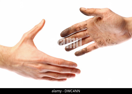 Handshake with a dirty hand and a clean one. - Stock Photo