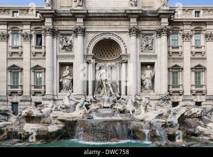 Tourists gather to admire the Trevi Fountain, Rome, Italy - Stock Photo