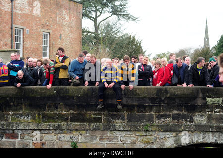 Ashbourne, Derbyshire, UK. 5th March 2014. Ash Wednesday and day two of the shrovetide football match .Up,ards go - Stock Photo