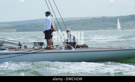 J-Class yacht crew of Ranger 2012 in the Solent during the J-Class regatta. - Stock Photo