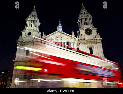 Red bus passing St- Paul's cathedral, London, England - Stock Photo