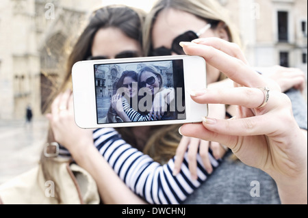 Two young female friends taking a self portrait, Valencia, Spain - Stock Photo