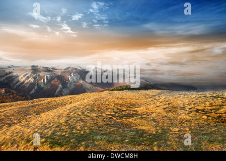 Late autumn in the mountains at sunset - Stock Photo