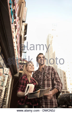 Young tourist couple with maps, New York City, USA - Stock Photo