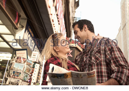 Young tourist couple holding maps, New York City, USA - Stock Photo