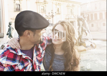 Tourist couple, Plaza de la Virgen, Valencia, Spain - Stock Photo