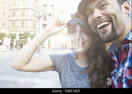 Tourist couple sightseeing, Plaza de la Virgen, Valencia, Spain - Stock Photo