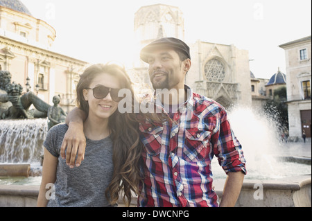 Tourist couple posing, Plaza de la Virgen, Valencia, Spain - Stock Photo