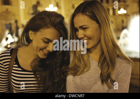 Two young women tourists, Plaza de la Virgen, Valencia, Spain - Stock Photo