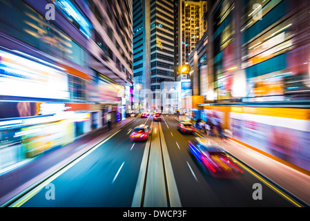 Hong Kong, China motion blur through the city from a streetcar. - Stock Photo
