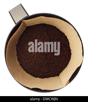Ground coffee in filter holder isolated on white background overhead view - Stock Photo