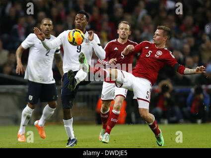 London, UK. 5th Mar, 2014. Daniel Sturridge(2nd L) of England vies with Peter Ankersen of Denmark during an international - Stock Photo
