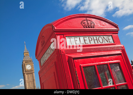Red phone box in London UK - Stock Photo