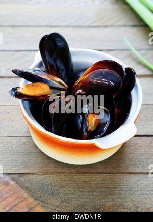 mussels cooked in a saucepan, food closeup - Stock Photo