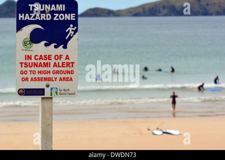 Tsunami hazard zone sign in the east coast of New Zealand - Stock Photo