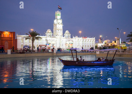 Yemen Pavilion and canal with abra water taxi at  Global Village tourist cultural attraction in Dubai United Arab - Stock Photo