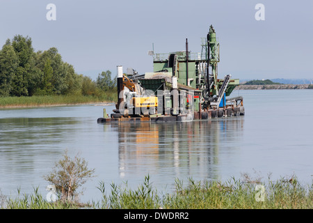 Austria, Vorarlberg, Hard, Nature Reserve Rhine Delta, float with digger of gravel - Stock Photo