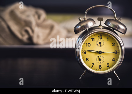 Vintage Alarm Clock In Bedroom On A Night Table By The Bed.   Stock Photo