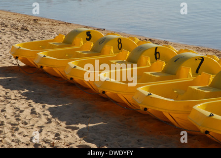 Pedal boats on beach. - Stock Photo