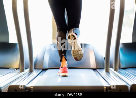 Low section of woman exercising on treadmill - Stock Photo