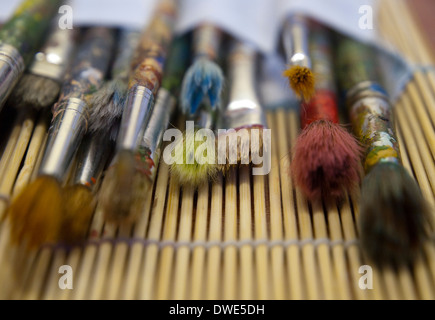 Close up of well used paintbrushes. - Stock Photo