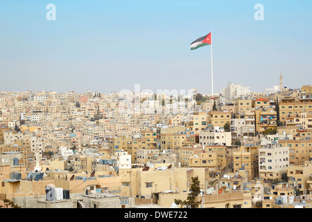 Amman city view with big Jordan flag and flagpole - Stock Photo
