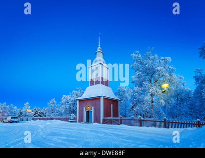 Small Wooden Church in Jukkasjarvi, Lapland, Sweden Cold winter temperatures -47 celsius. - Stock Photo