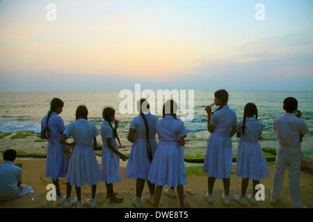Sri Lanka; Colombo, Galle Face Green, beach, sunset, schoolchildren, - Stock Photo