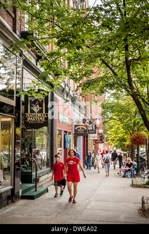 Tourists on Main Street Cooperstown New York - Stock Photo