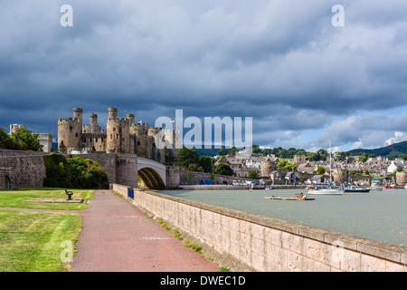 Waterfront park in front of Conwy Castle and harbour, Conwy, North Wales, UK - Stock Photo