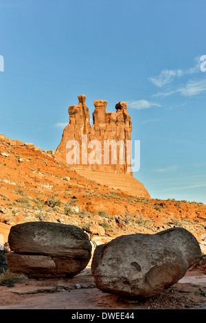 Three Gossips and boulders, Park Avenue trail, Arches National Park, Moab, Utah USA - Stock Photo